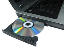 DVD ROM on a laptop opened to show disc. Isolated. Royalty Free Stock Photo
