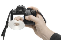 DVD Shot. A hand reaches out of a digital camera Stock Images