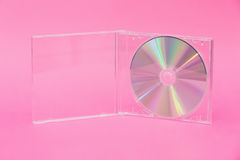 DVD in transparent box on pink background Stock Photography