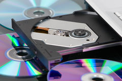 DVD tray opened. An opened DVD tray of a laptop with scattered disk around it Stock Photo