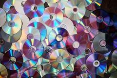 DVD und CD Hintergrund lizenzfreies stockbild