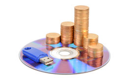 DVD and USB disk with coins Royalty Free Stock Photos