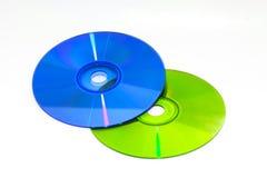 DVD y CD del color Fotos de archivo