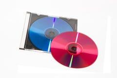 DVD y CD del color con la caja Foto de archivo libre de regalías