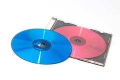 DVD y CD del color con la caja Fotografía de archivo libre de regalías