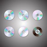 DVD y sistemas CD del disco Discos del ordenador Imagen realista stock de ilustración