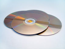 DVDs. 4 DVDs spread out on a white background stock images