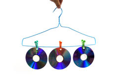 DVDs-hanger. DVDs clip on the clothes-hanger stock photography