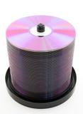 DVDs púrpura o Cdes en el eje de rotación Foto de archivo libre de regalías