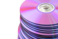 DVDs variopinto impilato o Cd Fotografia Stock Libera da Diritti