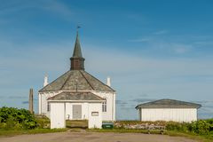 Dverberg church, Lofoten. Dverberg church on the island of Andoya in Lofoten. This octagonal wooden church from 1843 has a seating capacity of 350 Royalty Free Stock Photography