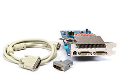 DVI cable, adapter and video graphic card. Stock Photo