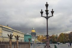 Dvortsovaya Square and Saint Isaak`s cathedral. Autumn trees. Royalty Free Stock Photography