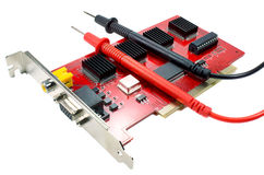 DVR motherboard with the probes of the multimeter on a white background Royalty Free Stock Photo