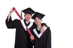 Dwa absolwentów szczęśliwy uczeń Zdjęcie Stock