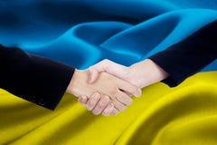 Dwa biznesów drużyna z Ukraina flaga Zdjęcia Stock