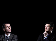Dwa biznesmenów patrzeć Obrazy Stock