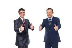 Dwa biznesmena pokazują znaka sukces Fotografia Stock