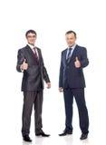 Dwa biznesmena pokazują znaka sukces Zdjęcia Royalty Free
