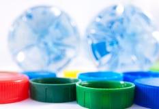 Dwa butelki i kolorowych pokrywy zdjęcia royalty free