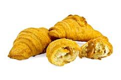 Croissants z słodzącym zgęszczonym mlekiem Zdjęcia Royalty Free