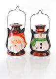 Dwa ceramiczny candlestick w postaci Santa i bałwanu. Obraz Stock