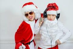 Dwa chłopiec udaje jest Zły Santa Obrazy Stock