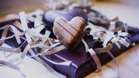 Dwa czekoladowego serca na purpurowym tle fotografia royalty free