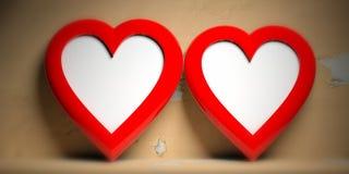 Dwa czerwieni serce kształtującej pustej ramy na kolorze żółtym izolują tło, kopii przestrzeń obraz royalty free