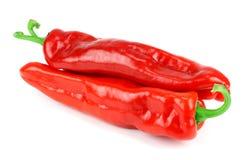 Dwa czerwonego pieprzu odizolowywającego na bielu Zdjęcia Royalty Free