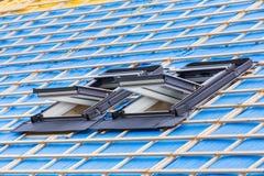 Dwa dachowego okno na dachu nowy dom obraz royalty free