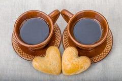 Dwa domowej roboty ciastka, dwa curs kawa Zdjęcie Royalty Free