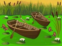 Dwa drewnianej łodzi w bagnie wśród jaskrawych motyli Obrazy Royalty Free