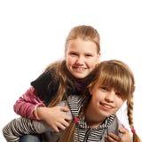 Dwa dziewczyn uśmiechnięty bawić się obraz royalty free