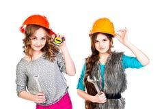 Dwa dziewczyny w budowa hełmach Zdjęcia Stock