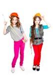 Dwa dziewczyny w budowa hełmach Obrazy Royalty Free