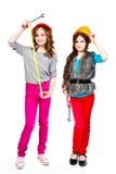 Dwa dziewczyny w budowa hełmach Fotografia Royalty Free