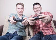 Dwa facetów bawić się Zdjęcia Stock