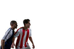 Dwa gracza futbolu broni each inny podczas gdy bawić się piłkę nożną obrazy royalty free