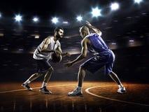 Dwa gracza koszykówki w akci Obraz Royalty Free