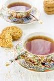 Dwa iapan stily filiżanki herbata z ciastkiem Zdjęcia Royalty Free