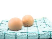 Dwa jajko na tkaninie i odizolowywający Obrazy Stock