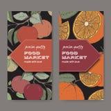 Dwa jedzenie targowej etykietki z koloru jabłkiem i pomarańcze rozgałęziają się Fotografia Royalty Free