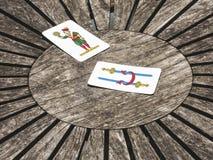 Dwa karty na drewnianym stole Fotografia Royalty Free