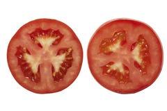 Dwa kawałka obruszenie pomidory fotografia royalty free