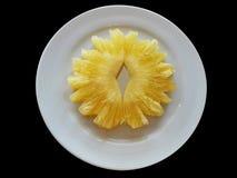 Dwa kawałka ananasy na bielu talerzu Obraz Royalty Free