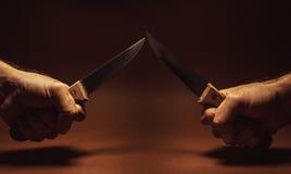 Dwa Knifes I Dwa ręki Zdjęcie Royalty Free