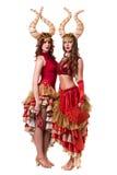 Dwa kobieta tancerza z rogami Odizolowywający na bielu Obraz Stock