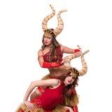 Dwa kobieta tancerza z rogami Odizolowywający na bielu Zdjęcia Royalty Free