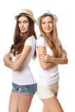 Dwa kobiety stoi opierać na each inny Obrazy Royalty Free